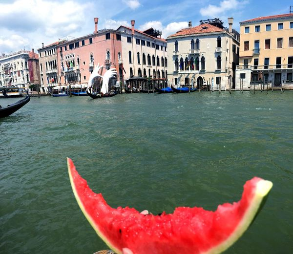 Summer in my hands Building Exterior Built Structure Canal Gondola - Traditional Boat Travel Destinations Outdoors Sky Day First Eyeem Photo Architecture Summertime Watermellon  Fruit Water Freshness Sculpture Art venice Venice, Italy