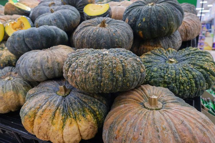 Close-up of pumpkins for sale at market
