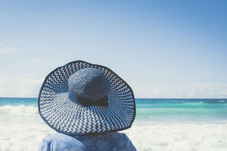 Blue Beauty In Nature Blue Blue Color Color Palette Color Palette Day Hat Horizon Over Water Idyllic Nature Ocean Outdoors Remote Rippled Scenics Sea Seascape Sky Sunhat Tranquil Scene Tranquility Vacations Water Wave