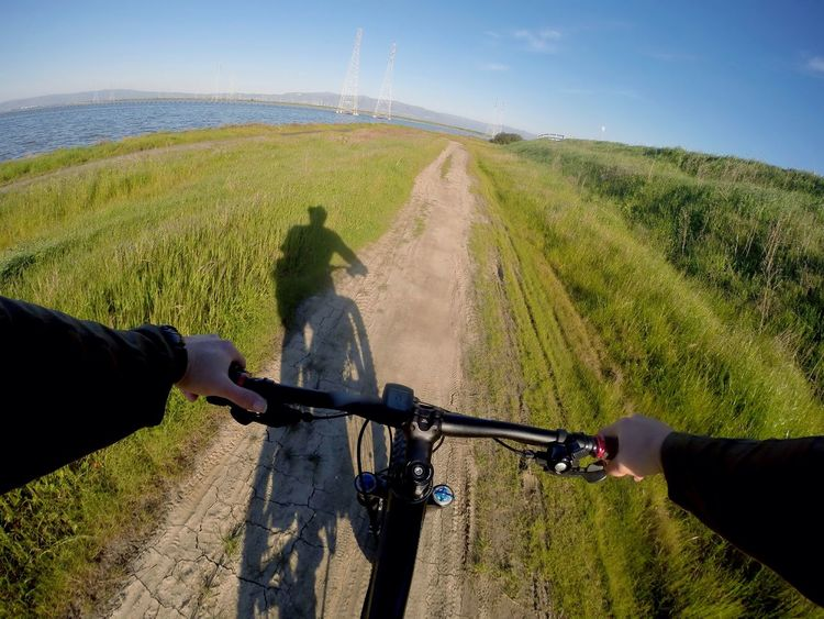 San Francisco Bay California Bike Bicycle MTB Mountainbike Perspective Personal Perspective POV Shadow Rider Lifestyles Human Hand Handlebar Outdoors Grass Water Beauty In Nature Landscape No Budget Photography