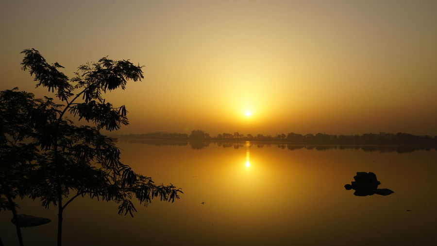 Reflection Tree Sky Nature Scenics Water Lake No People Tranquility Outdoors Landscape Beauty In Nature Tranquil Scene Silhouette Beauty Tree Area Sunrise Sunrise Silhouette Sunrise Collection 2017 Hyderabaddiaries SonyAlpha6000 Nwin Photography Beauty In Nature Golden Hour Sunrise Photography