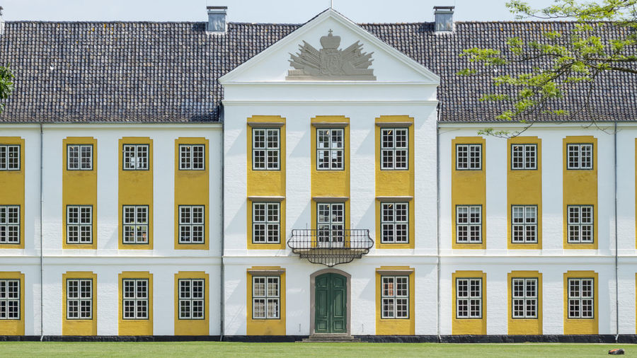 Augustenborg Castle is one of the most beautiful Baroque palaces in Denmark Architecture Built Structure Building Residential District Yellow House Façade Door Apartment Augustenborg Castle In Denmark Augustenborg Castle