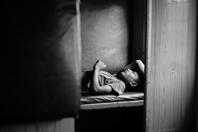 Guy sleeping in train sitPeoplelSleepingnTrainin The Global EyeEm Adventure Week On Eyeem Eyeemmarket Bangladesh Traveling Travel Photography Lifestyles Blackandwhite EyeEmNewHere Capture Tomorrow