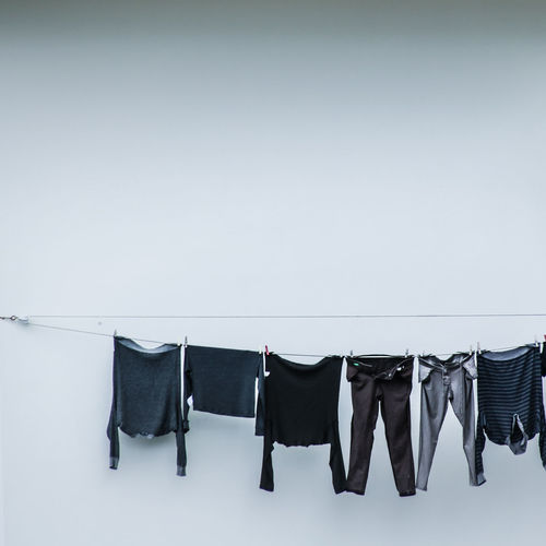 Hanging Clothing Clothesline Drying No People Copy Space In A Row Side By Side White Color Group Of Objects Indoors  Laundry White Background Coathanger Wall - Building Feature Studio Shot Rack Black Color Variation Medium Group Of Objects Clean