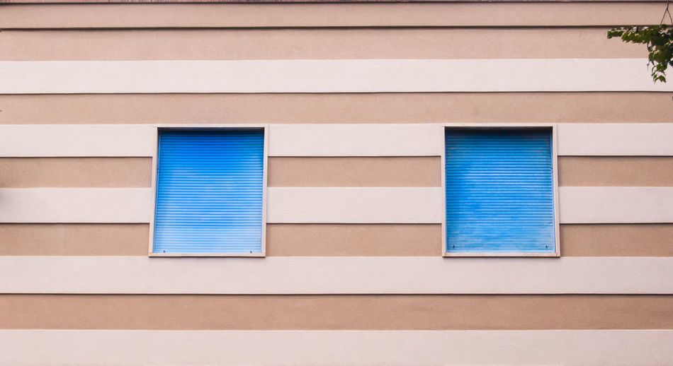 Bicolors Architecture Blue Building Building Exterior Built Structure Day Full Frame Geometric Shape Glass - Material Horizontal Symmetry House Linearity Low Angle View No People Outdoors Pattern Residential District Shutter Wall Wall - Building Feature White Color Window