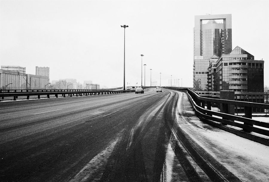 Empty Moscow streets on the 1st of Jan, shooted on film Ilford Delta 400 35mm 35mm Film B&w B&w Film Black Blackandwhite Canon AE-1 Program  City Cityscape Empty Film Film Photography Filmcamera Ilford Delta 400 Moscow Russia Streets Urban Urban Geometry Winter