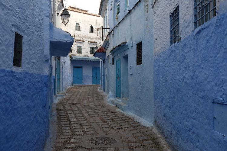 Narrow street amidst buildings in town