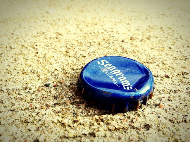 A lonley piece of trash laying on the ground, yelled at me to see it...I did. 🤗 Bottle Top Metal Trash Pavement Eye4photography  Up Close Street Photography Up Close Blue Storytelling EyeEm Gallery I See Taking Photos Beer