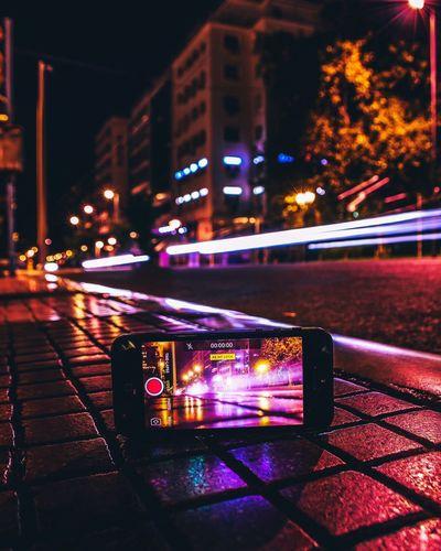 Illuminated building by street at night