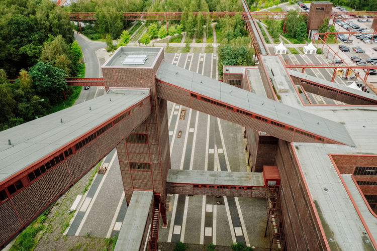 Zeche Zollverein Architecture Bridge Bridge - Man Made Structure Building Building Exterior Built Structure Communication Day High Angle View House Nature No People Old Outdoors Plant Railing Residential District Text Tree Wood - Material