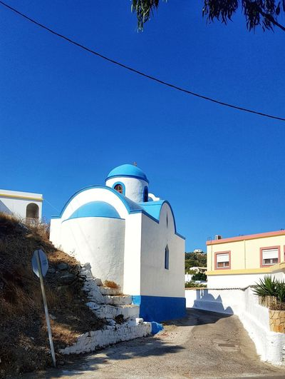 Blue Sky Blue Greece Chapel Greece GREECE ♥♥ Greece Photos Leros Leros Island Leros Greece Clear Sky Blue Whitewashed Place Of Worship Sunlight Sky Architecture Building Exterior Built Structure Cross Bell Tower Religion Spirituality Church