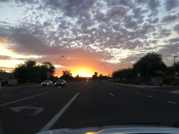 Desert Sunset in Chandler Arizona Car Transportation Land Vehicle Sunset Car Interior Vehicle Interior Mode Of Transport Windshield Cloud - Sky Car Point Of View Road Sky Travel No People Dashboard The Way Forward Tree Day Outdoors