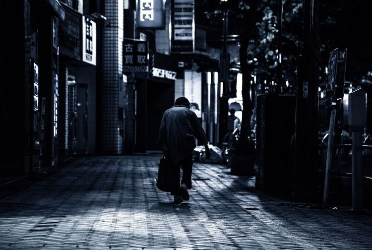 Walking Full Length Rear View Architecture Built Structure Building Exterior City Street Men The Way Forward Casual Clothing City Life Outdoors Footpath Residential District Diminishing Perspective Building Story