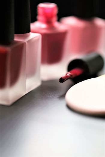 No People Table Still Life Red Lipstick Indoors  Selective Focus Close-up Make-up Container Beauty Product Nail Single Object Pink Color Nail Polish Studio Shot Relaxation Warning Sign Aggression