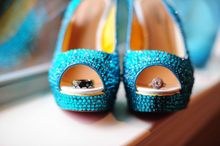 Red bottom shoes I photographed for a wedding. I placed the bride and groom rings in the shoes. Still Life Fashion Blue No People Table Close-up Indoors  Day Multi Colored High Heels Red Bottoms Rings Ring Rings 💍 Wedding Ring Photography Beautiful Photography Diamond Diamonds Diamonds Are A Girl's Best Friend