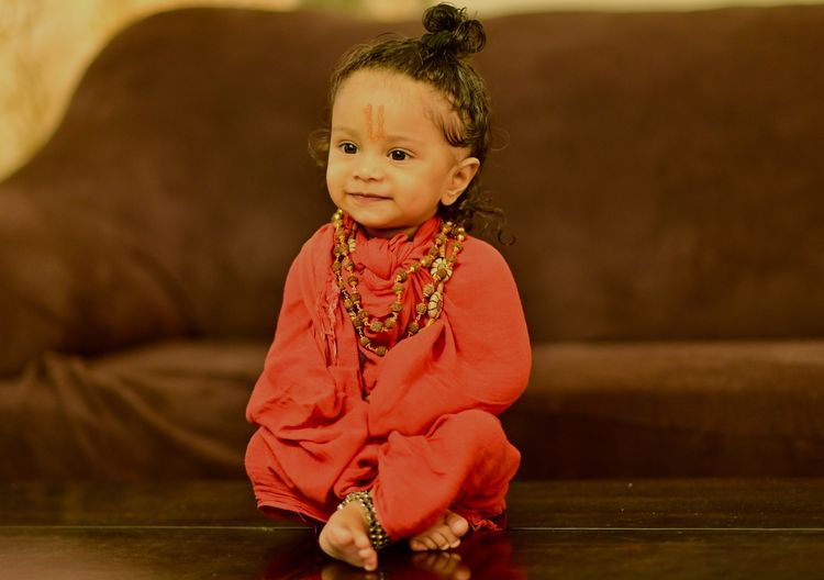 The little yogi's smile radiates with unadulterated happiness.