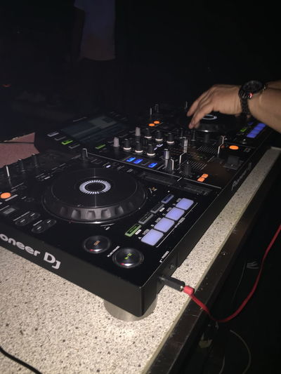 Arts Culture And Entertainment Close-up Club Dj Control Panel Dj High Angle View Human Body Part Human Hand Indoors  Mixing Music Nightclub Nightlife Performance Record Sound Mixer Technology Turntable