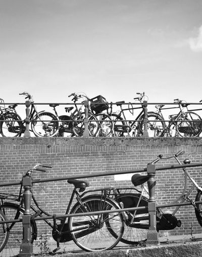 Parked or locked bicycles in Amsterdam. Amsterdam Amsterdam Canal Amsterdam City City City Life City Street Locked Parked Bikes The Netherlands Amsterdamcity Architecture Bicycle Bicycles Bike Bikes Bridge Bridge - Man Made Structure Built Structure Day Nature Outdoors Parked Bicycle Parked Bike Sky Transportation