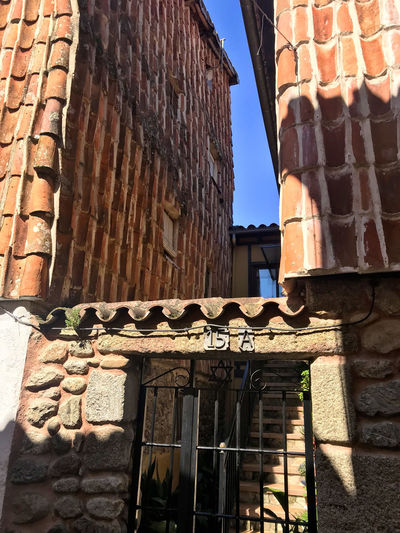 Building Exterior Architecture Built Structure Building Low Angle View Day No People Window Wall Nature Roof Sunlight House Brick Old Sky Brick Wall Wall - Building Feature Residential District Roof Tile Outdoors Stone Wall