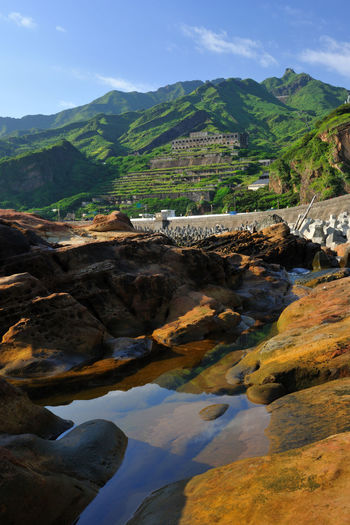 ShueiNanDong Smelter magnificent historical buildings magnificent Monuments ShueiNanDong ShueiNanDong Smelter Beauty In Nature Coastal Day Historic Buildings  Landscape Mining Area Mountain Mountain Range Nature No People Outdoors River Scenics Sky Tranquil Scene Tranquility Travel Destinations Water Yinyang Sea