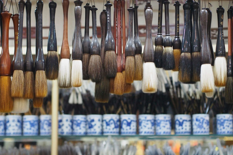 Brushes hanging in market for sale