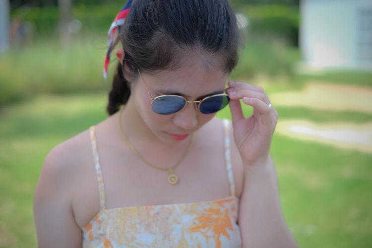 Portrait of a girl wearing sunglasses
