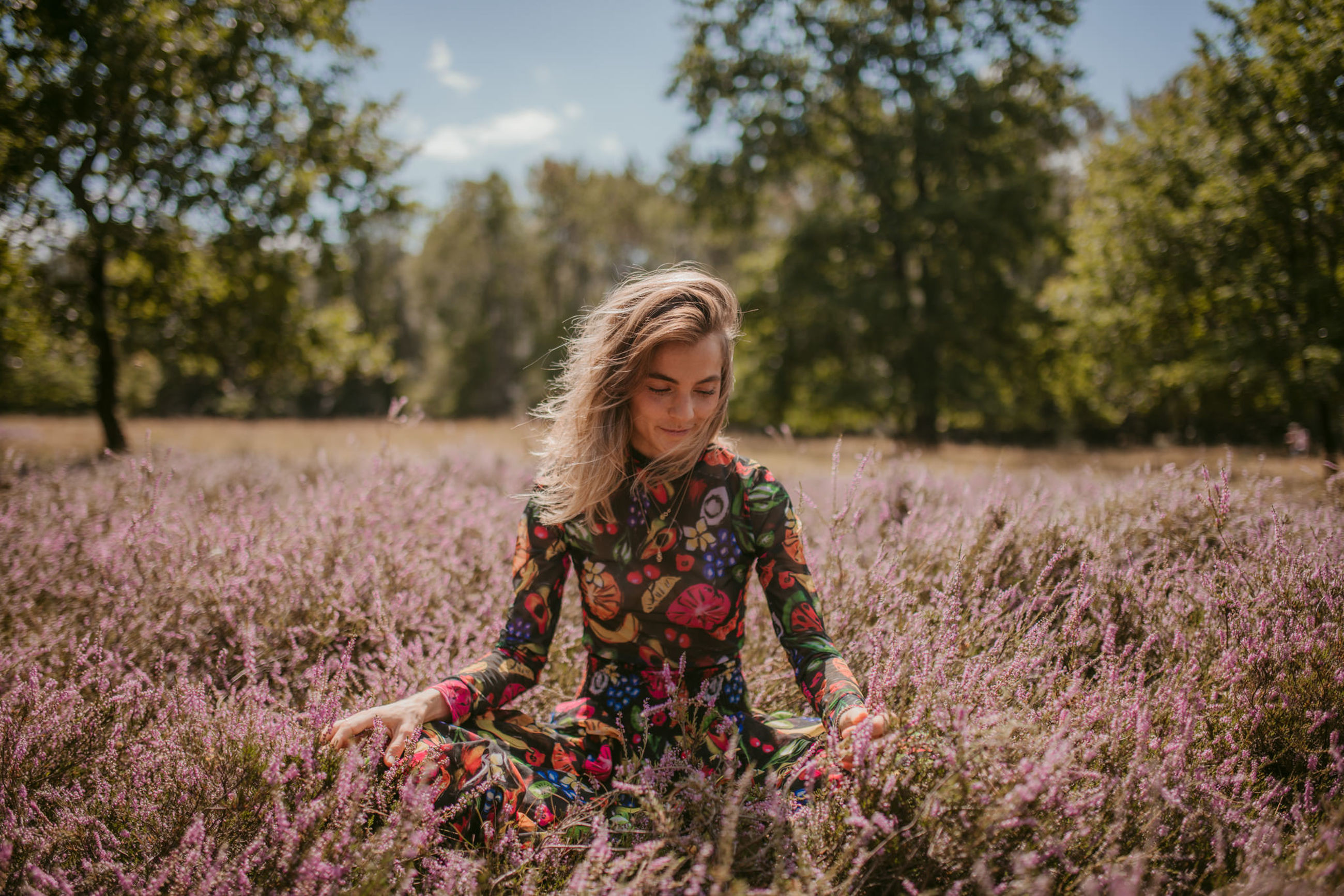 plant, one person, hair, women, real people, growth, leisure activity, tree, nature, lifestyles, blond hair, front view, land, hairstyle, field, day, young adult, casual clothing, flowering plant, beautiful woman, outdoors