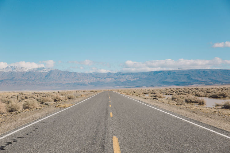 Empty road at death valley against sky