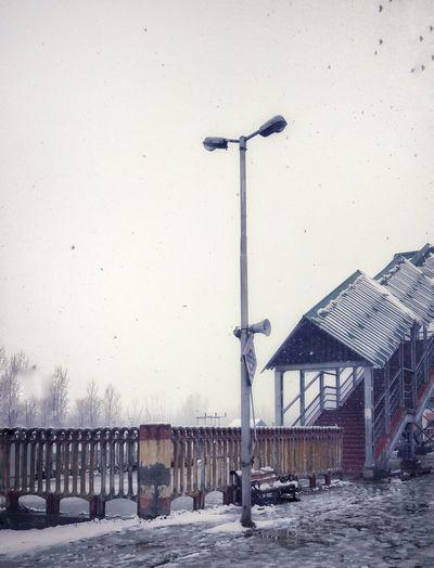Street light on snow against clear sky