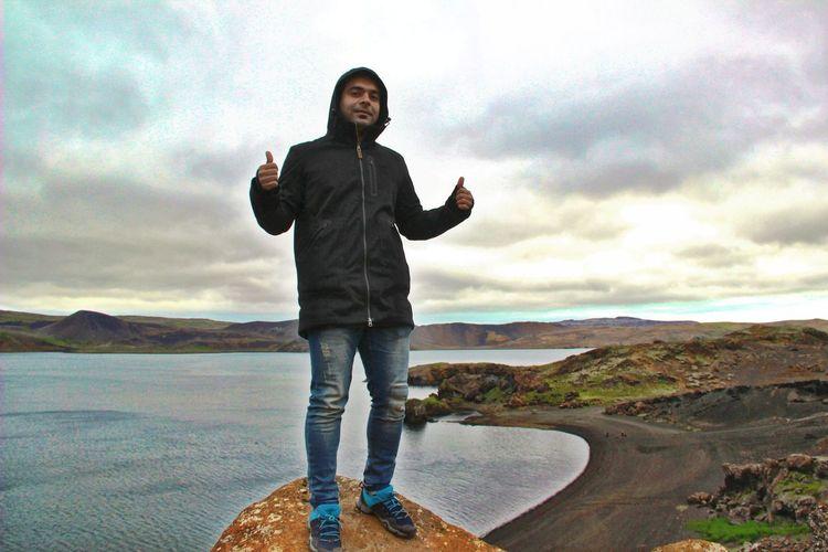 Full length portrait of man standing on shore