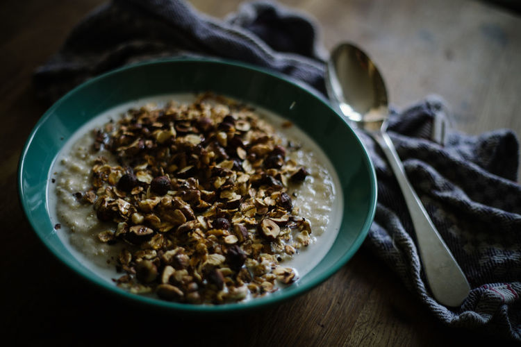 Porridge with roasted nuts and maple syrup Breakfast Nuts Porridge Rustic Steel Cut Oatmeal Bowl Close-up Day Food Food And Drink Freshness Healthy Eating Indoors  Oatmeal Roasted