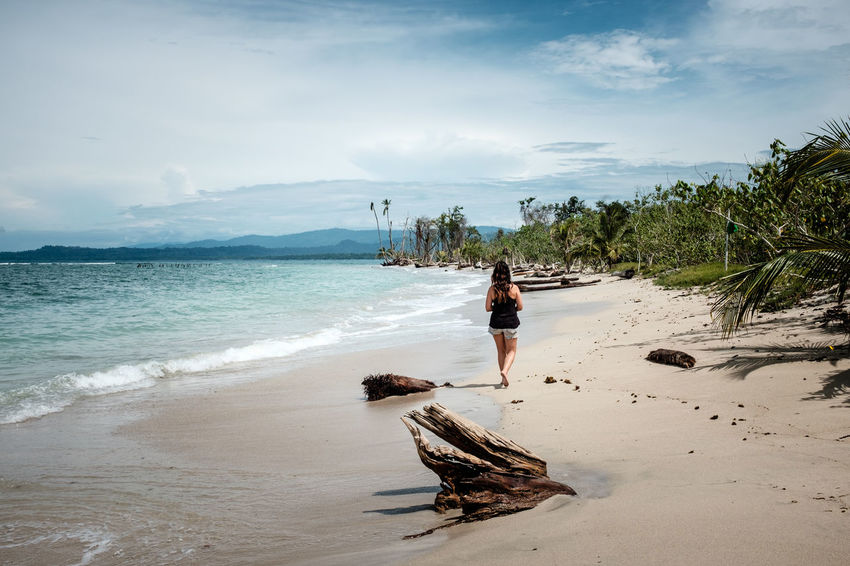 Beach Beauty In Nature Cahuita Cloud Cloud - Sky Full Length Leisure Activity Mountain Nature Non-urban Scene Sand Scenics Sea Shore Sky Summer Tourism Tourist Tranquil Scene Tranquility Travel Destinations Vacations Water Wave Woman Lost In The Landscape