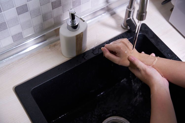 High angle view of woman hand in kitchen at home