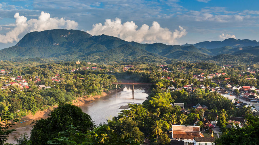 Scenic view of mountains and river in town