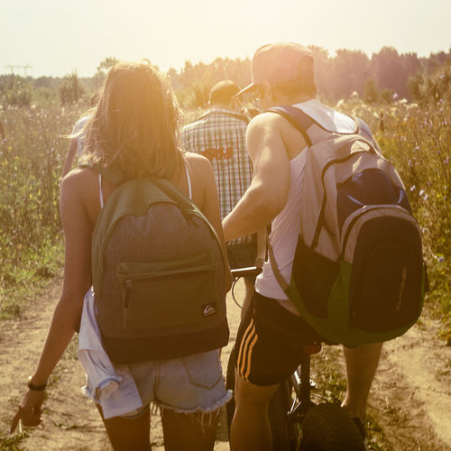 Hiking Life Lifestyle Backpack Bonding Day Field Hiker Leisure Activity Lifestyles Men Nature Outdoors Real People Rear View Sky Sun Sunlight Sunset Togetherness Tree Two People Women Young Adult Young Women