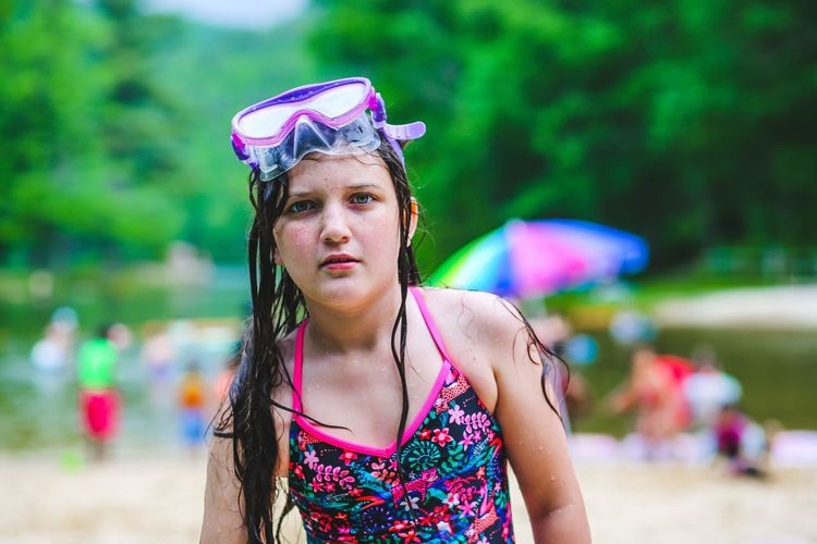 My little mermaid loves her lake days. Childhood Swimwear Goggles Swimming Portrait One Person Front View Looking At Camera Lifestyles Women Focus On Foreground Leisure Activity Clothing Day Hair Real People Hairstyle Outdoors Standing