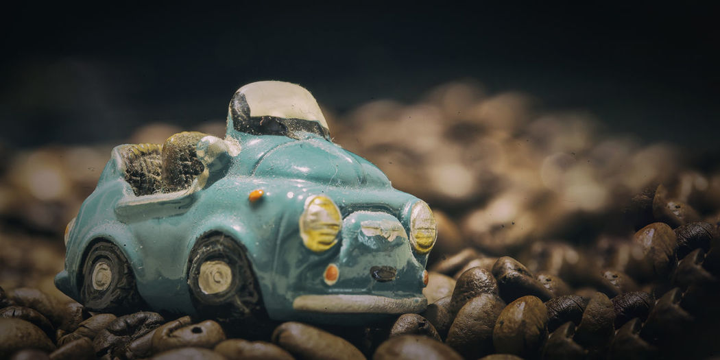 Close-Up Of Toy Car On Roasted Coffee Beans