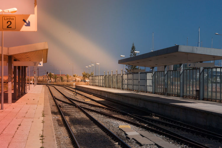 Architecture Building Exterior Built Structure City Day Electricity Pylon Illuminated No People Outdoors Rail Transportation Railroad Station Railroad Station Platform Railroad Track Sky Smoke Stack Station Sunset Transportation