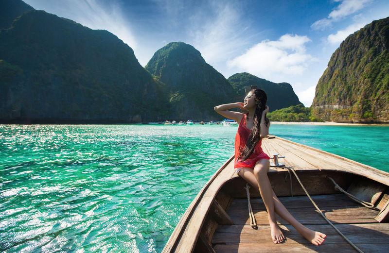 Adult Beauty In Nature Day Full Length Human Arm Leisure Activity Lifestyles Mountain Nature Nautical Vessel One Person Outdoors Real People Scenics - Nature Sky Tranquil Scene Tranquility Transportation Water Women Young Adult