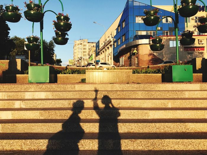 Shadow Built Structure Building Exterior Architecture Real People Sunlight Street Light Two People Outdoors Day City Men Sky People Sunset Silhouettes Sunset_collection Silhouette Sunset Sommergefühle Connected By Travel