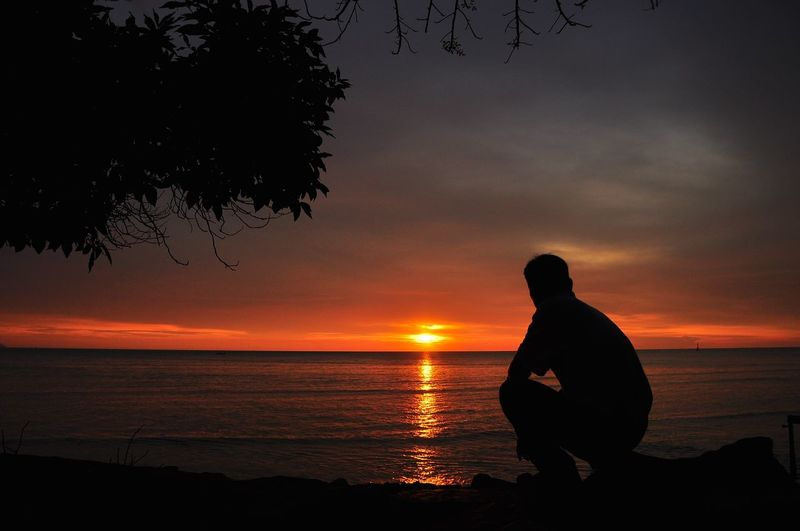Sunset Nature Sea One Person Silhouette Beauty In Nature Sky People Adult Outdoors One Man Only Adults Only