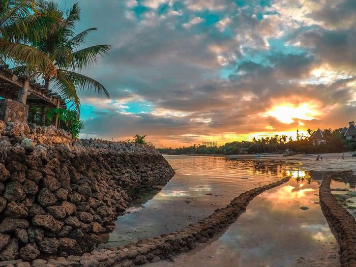 Beach Beauty In Nature Cloud - Sky Day Eyeem Philippines Nature No People Outdoors Palm Tree Reflection Sky Sunset Tree Vacations Water