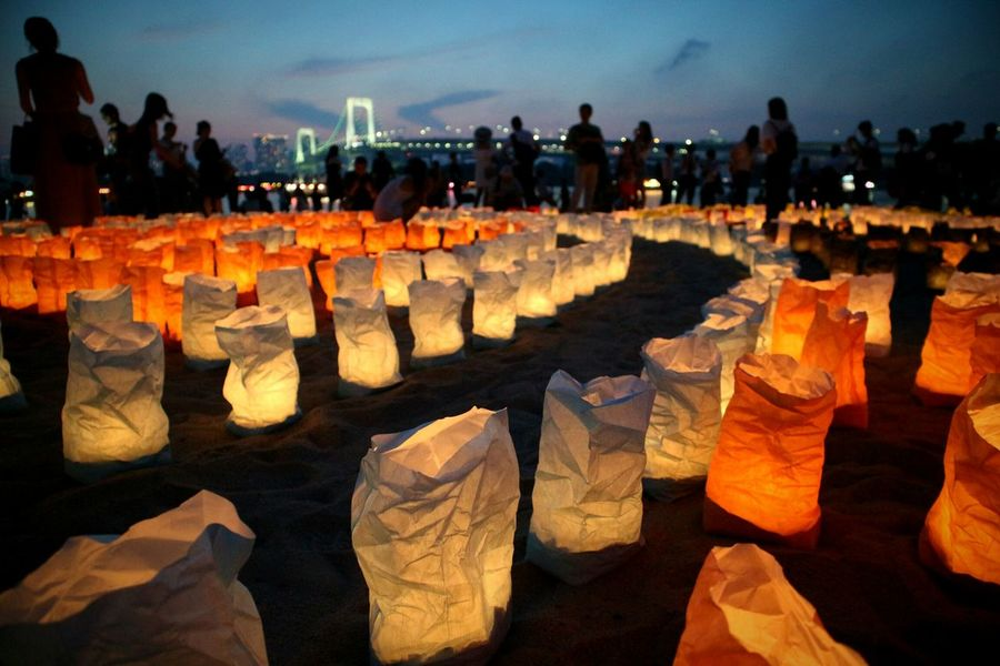 Lanterns In A Night Sky Beach In A Row Arts Culture And Entertainment Colors Enjoying The Moment Taking Photos Night Nature Sky Illuminated Panoramic Crowd EyeEm The Best Shots Summer Landscape Photograpy Sand CaptureTheMoment People EyeEm Gallery Outdoors Lights Bridge