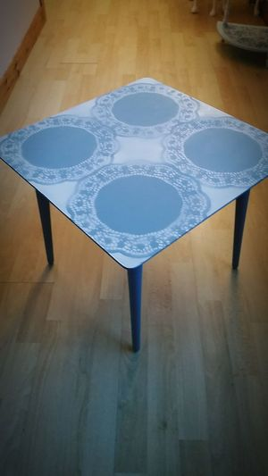 "Blue end table with white ""doily"" print. £15."