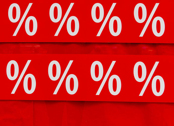 Sale Backgrounds Business Close-up Communication Consumerism Full Frame Illuminated Indoors  Information No People Orthographic Symbol Percentage Sign Red Retail  Shopping Sign Single Word Store Text Western Script