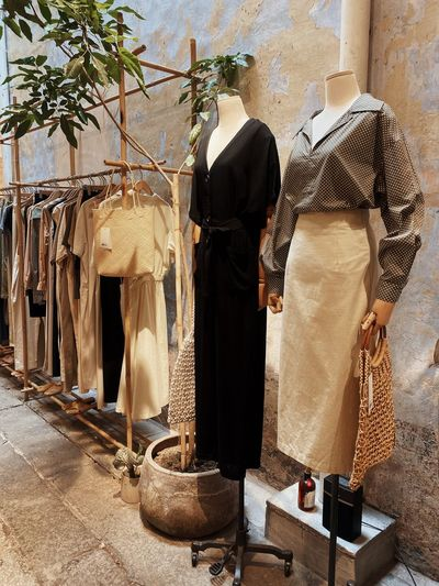 Rear view of clothes for sale at store