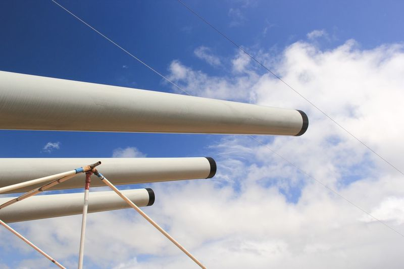 Low Angle View Of Cannons In Battleship Against Sky