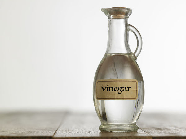white vinegar on the wooden table top Cooking Food And Drink Liquid Natural Wood Acetic Bottle Clear Close-up Condiment Container Food Glass - Material Indoors  Ingredient Label No People Savory Food Studio Shot Table Top Taste Text Transparent Water White Vinegar