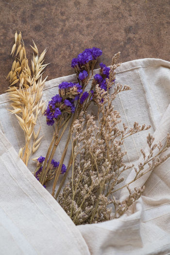 High angle view of flowers on cloth at table