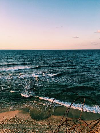 Sand and waves Sea Horizon Over Water Water Scenics Beauty In Nature Nature Tranquil Scene Tranquility Beach No People Idyllic Clear Sky Outdoors Sky Wave Blue Sunset Day